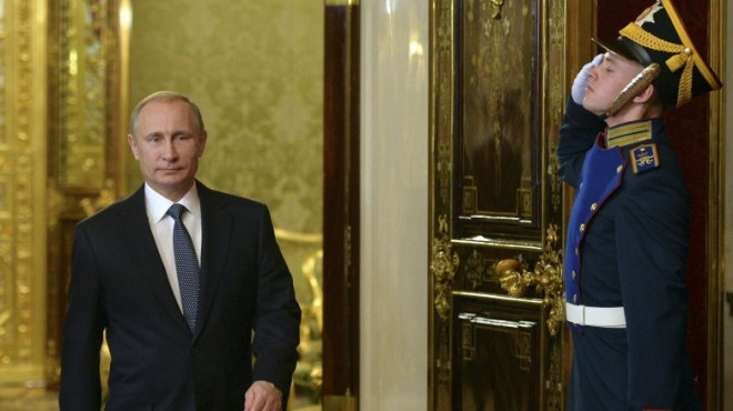 Russia-s-President-Putin-enters-a-hall-before-a-meeting-of-the-Collective-Securi