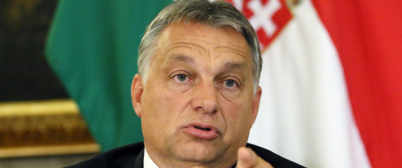 Hungarian Prime Minister Viktor Orban addresses the media on the occasion of a meeting with Austrian Chancellor Werner Faymann and Vice Chancellor Reinhold Mitterlehner at the Hungarian Embassy in Vienna, Austria, Friday, Sept. 25, 2015. (AP Photo/Ronald Zak)