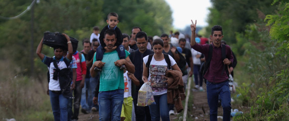 SZEGED, HUNGARY - SEPTEMBER 06:  Migrants and refugees celebrate as they cross the border from Serbia into Hungary along the railway tracks close to the village of Roszke  on September 6, 2015 in Szeged, Hungary.After days of confrontation and choas Hungary unexpectedly opened its borders with Austria allowing thousands of migrants to leave the country and travel onto Germany.  (Photo by Christopher Furlong/Getty Images)