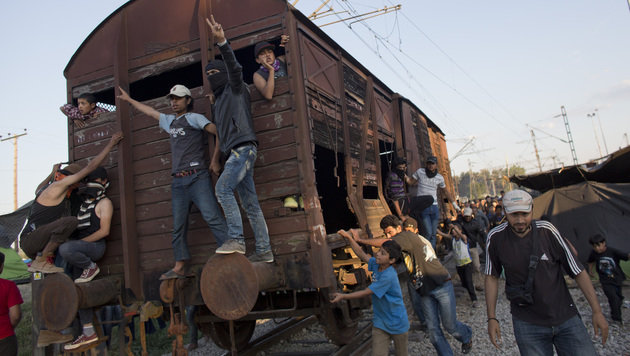 Migrants push a wagon through the camp towards Greek police at the Macedonian border, in Idomeni, Greece, Wednesday, May 18, 2016.  Thousands of stranded refugees and migrants have camped in Idomeni for months after the border was closed. (AP Photo/Darko Bandic)