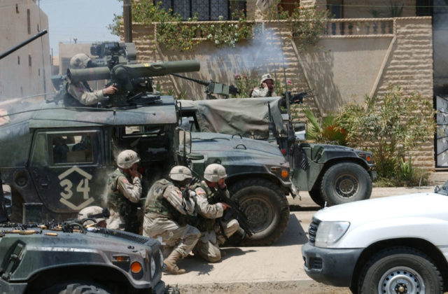 MOSUL, IRAQ - JULY 22:  In this handout photo provided by the U.S. Army, soldiers with the Army's 101st Airborne Division (Air Assault) fire a TOW missile at a building harboring Iraqis that included Saddam Hussein's sons, Qusay and Uday, July 22, 2003 in Mosul, Iraq.  Qusay and Uday were killed in the battle.  (Photo by Curtis G. Hargrave/U.S. Army/Getty Images)