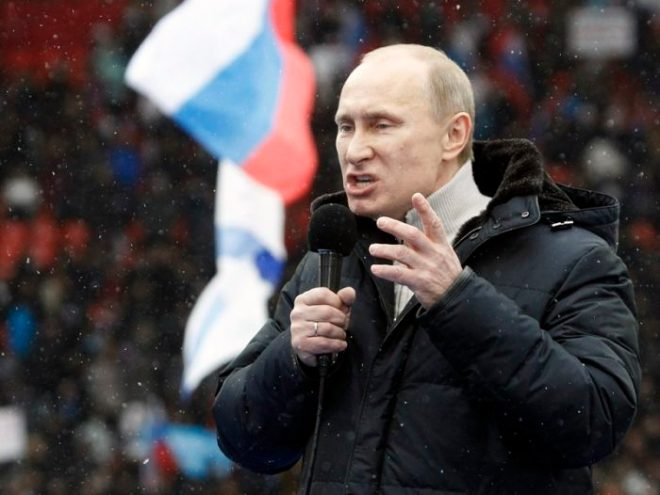 Presidential candidate and Russia's current Prime Minister Vladimir Putin delivers a speech during a rally to support his candidature in the upcoming presidential election at the Luzhniki stadium on the Defender of the Fatherland Day in Moscow February 23, 2012. Russia will go to the polls for a presidential election on March 4.  REUTERS/Sergei Karpukhin  (RUSSIA - Tags: POLITICS ELECTIONS ANNIVERSARY MILITARY)